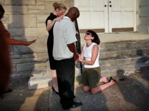 White woman begging for forgiveness for slavery